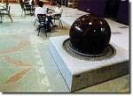Fountains and elaborate floor patterns help distinguish the various public piazzas throughout the community. Here a 10 ton solid granite ball floats on a water basin placed on a mosaic covered piazza